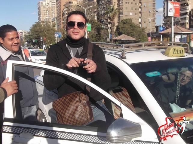 """شاهد بالصور الحصرية : عمرو زكى  يغادر  الزمالك فى """"تاكسى"""""""